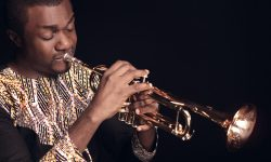 Nathaniel Bassey playing his trumpet